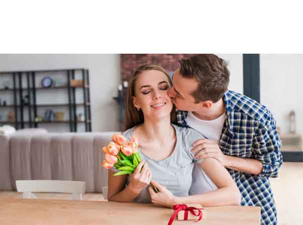 Man giving gift to wife on 1st anniversary